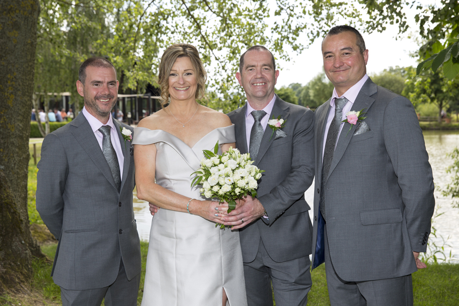 bride and groom with best men at Weald of Kent Golf Club in Headcorn