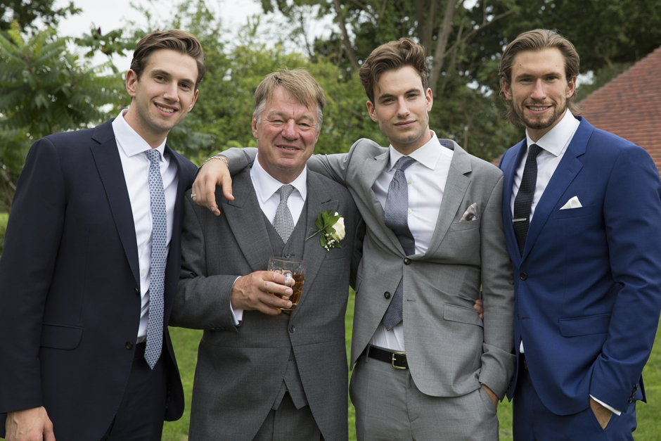 father of the bride with wedding guests at Smarden countryside village in Kent