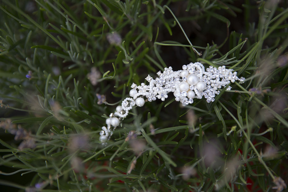 bride's hair piece captured with rosemary plant background