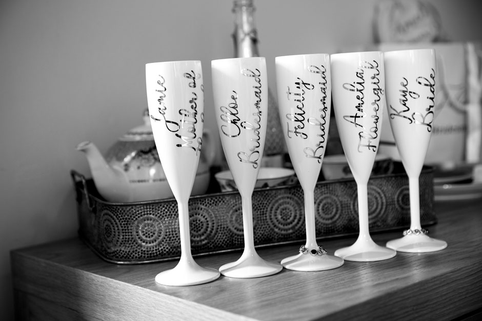 Bride and Bridesmaid's personalised champagne glasses captured at Wotton House in Dorking, Surrey