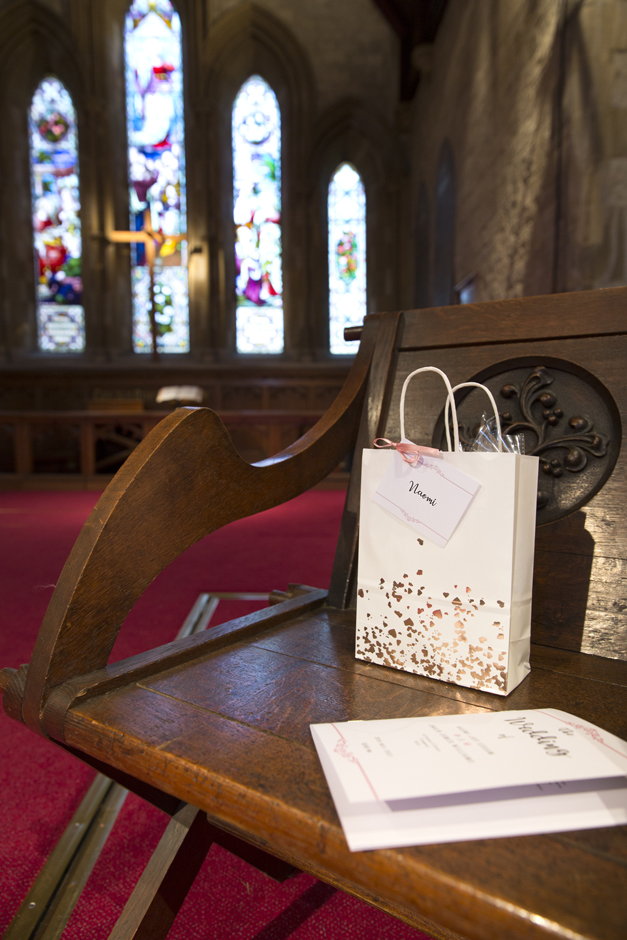 Personalised bags on bride and groom's chair at St Stephen's Church in Tonbridge, Kent.