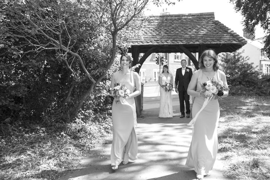 Bridal procession walking to St Stephen's Church in Tonbridge, Kent