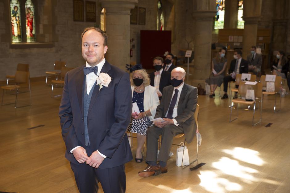 Groom waiting for bride nervously inside St Stephen's Church in Tonbridge, Kent