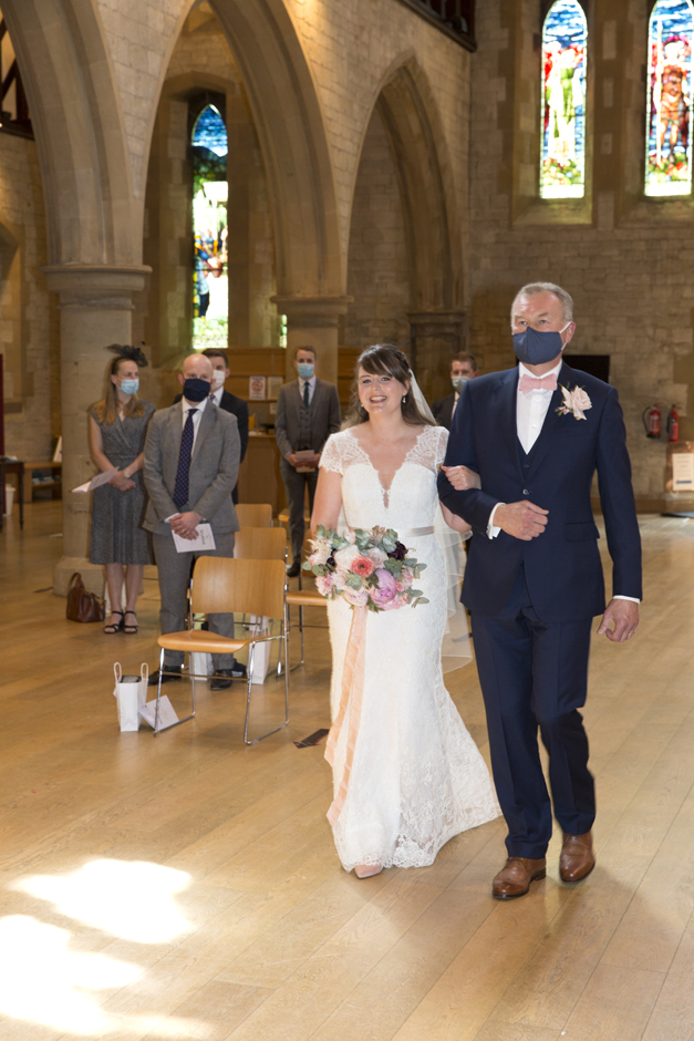 Bride and Father smiling walking down the aisle at St Stephen's Church wedding in Tonbridge, Kent