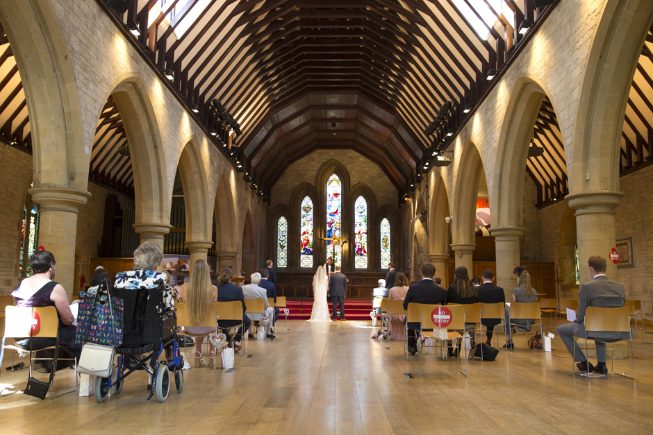 Wide angle of St Stephen's Church wedding in Tonbridge Kent with socially distanced 30 wedding guests