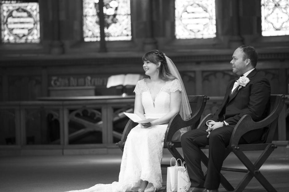 Bride and Groom listening to vicar's sermon at St Stephen's Church wedding ceremony in Tonbridge, Kent