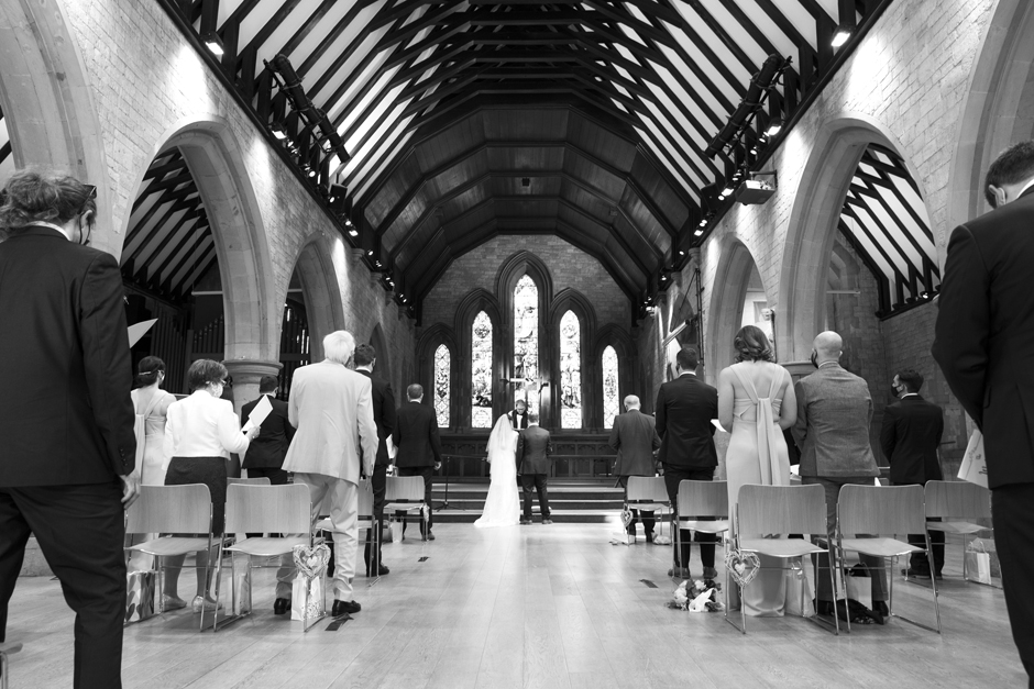 Bride and groom at socially distant wedding ceremony at St Stephen's church in Tonbridge, Kent
