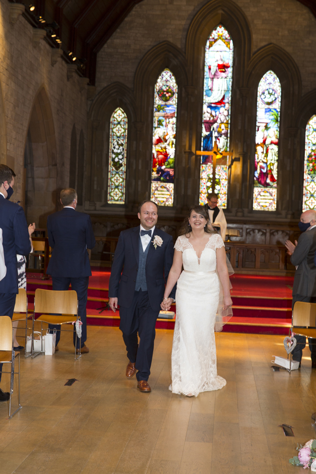 Bride and Groom walking up the aisle at St Stephen's Church in Tonbridge, Kent