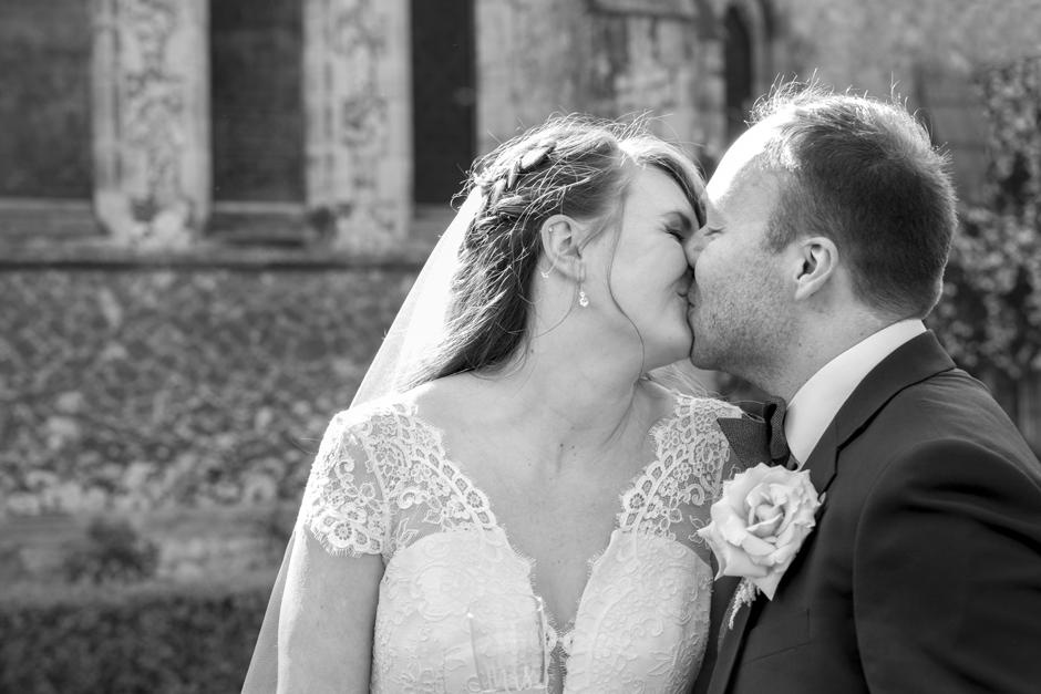 Bride and Groom kissing outside St Stephen's Church wedding in Tonbridge, Kent