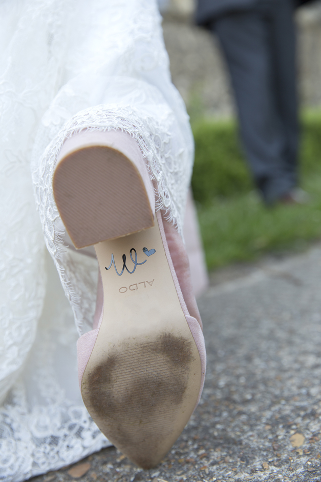 Bride's engraved new surname initial on back of shoe at Tonbridge wedding in Kent