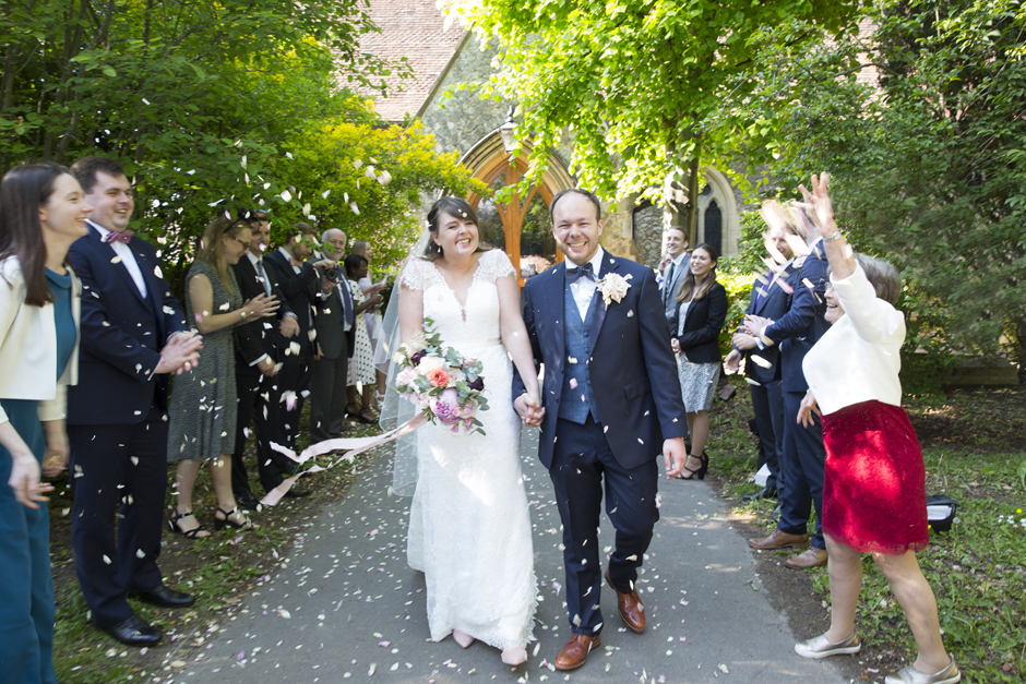 Bride and Groom confetti tunnel outside St Stephen's Church in Tonbridge, Kent