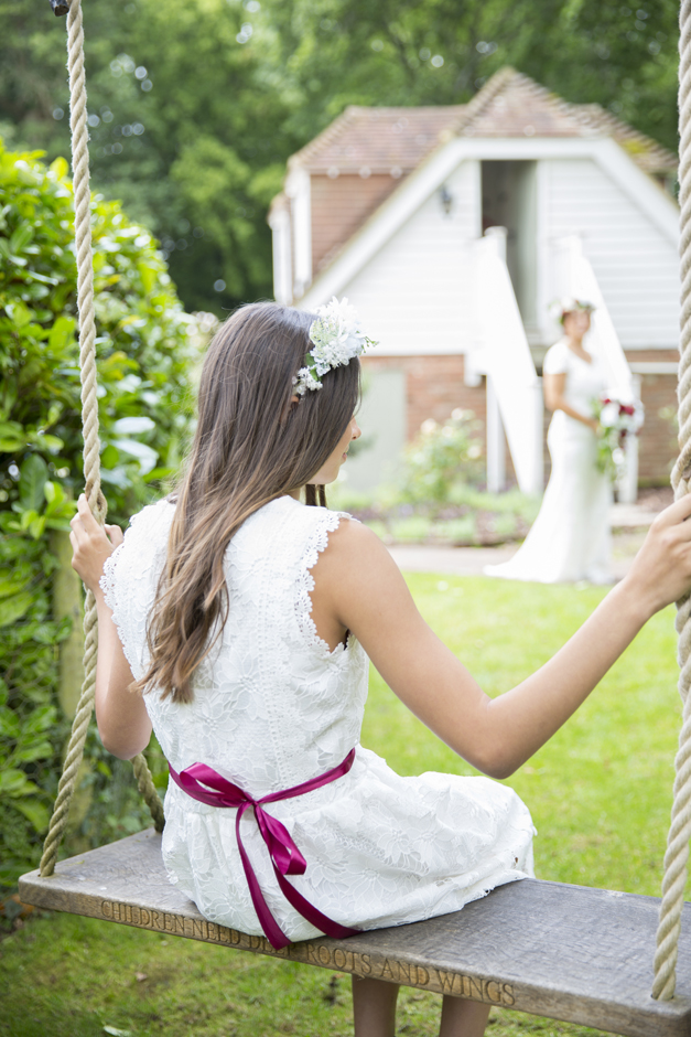 bridesmaid on swing captured by kent wedding photographer Victoria Green