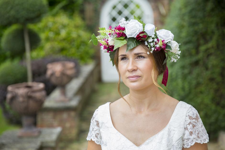 Bride with silk flowers wreath captured by Kent wedding photographer Victoria Green