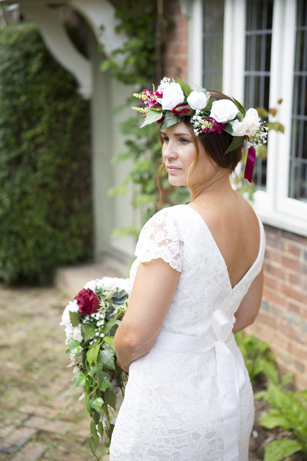 bride with silk flower wreath on her head and holding silk flower bouquet captured by Kent wedding photographer Victoria Green