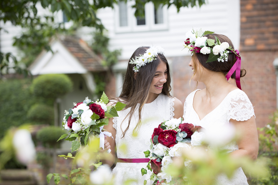Bride and bridesmaid laughing together captured by Kent wedding photographer Victoria Green