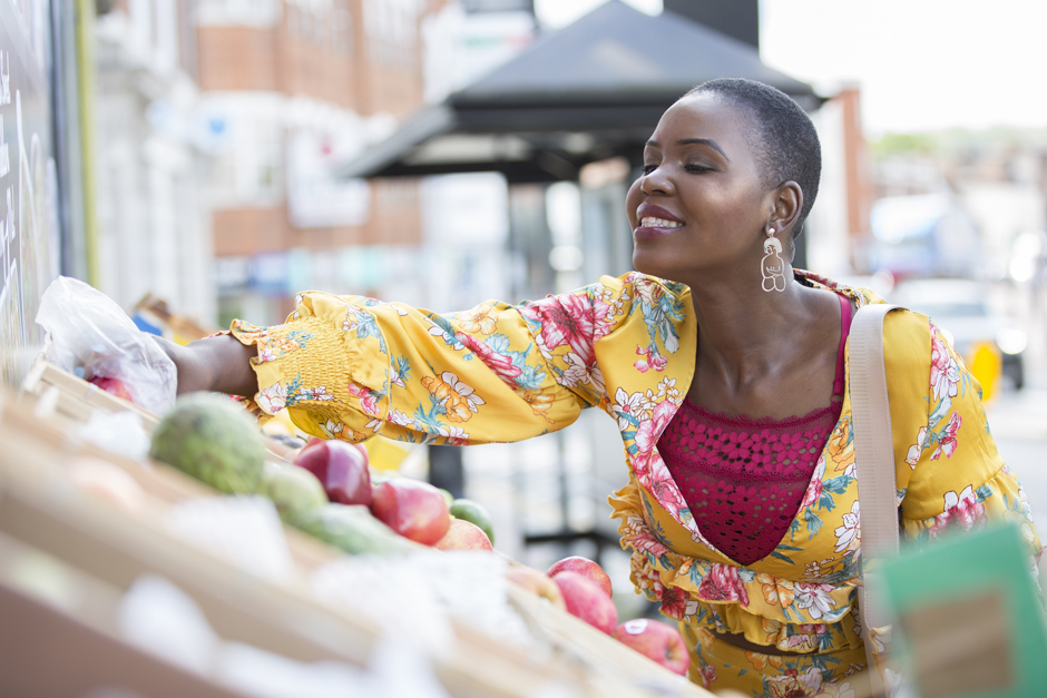 Black lady picking fruit and fruit stall captured by Kent photographer Victoria Green