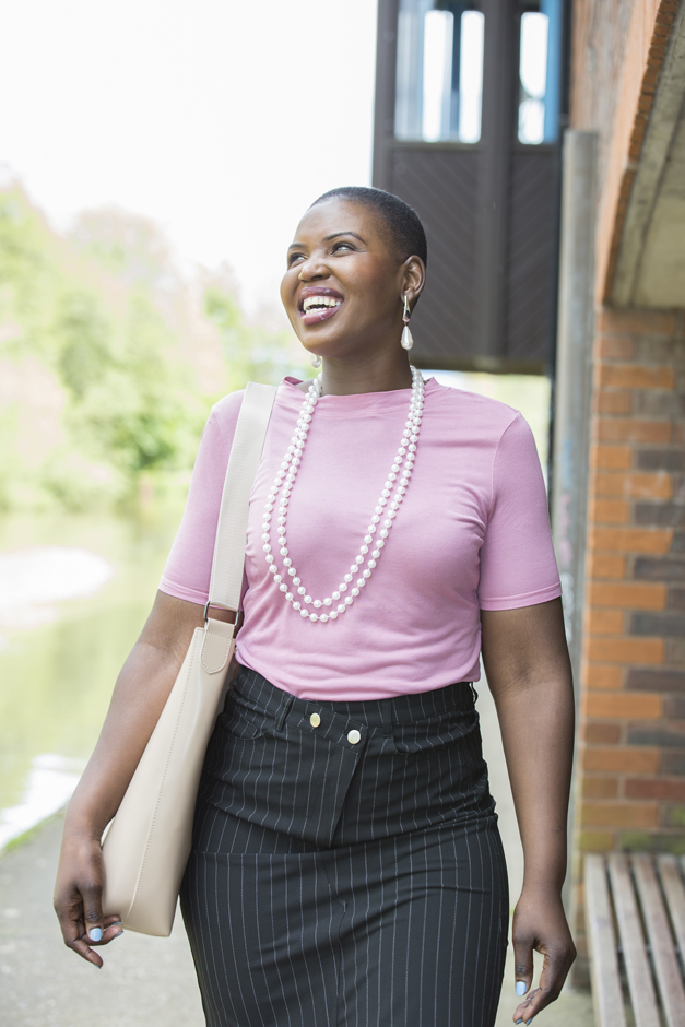 Black businesswoman laughing and walking