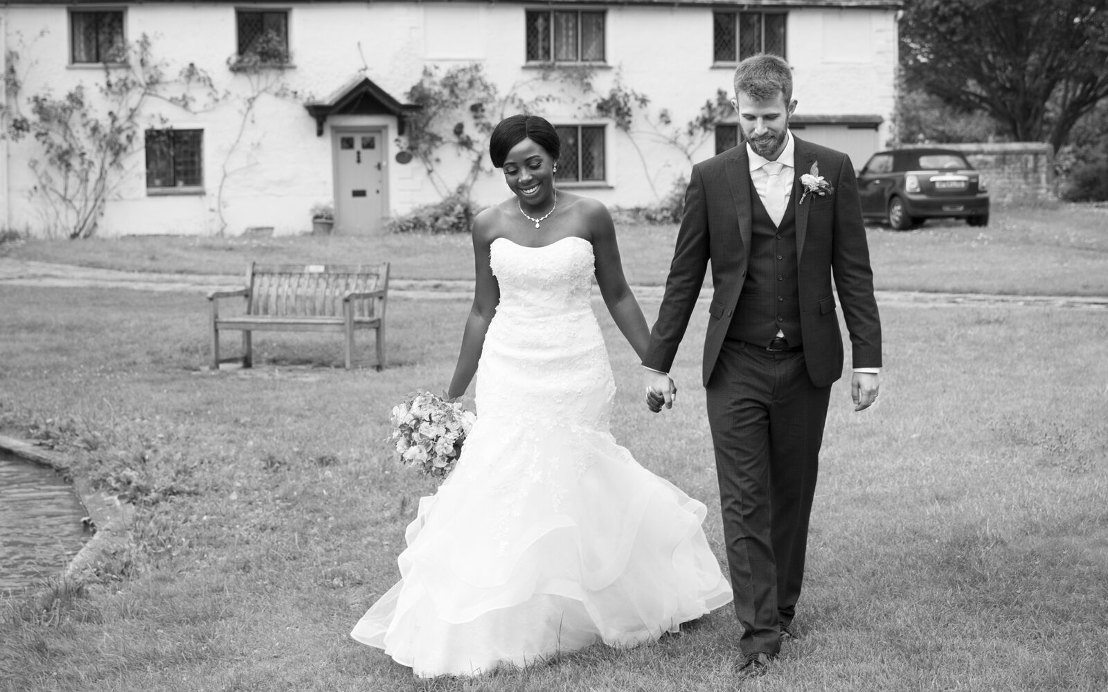 Bride and groom walking together smiling. Captured by Kent wedding photographer, Victoria Green.