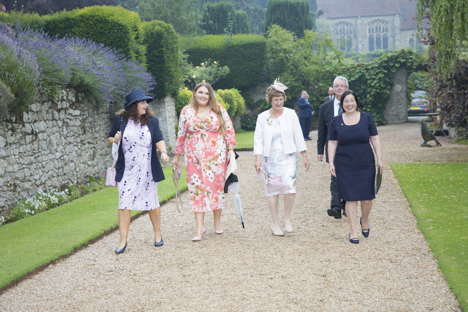 Guests arriving for outdoor ceremony at Nettlestead Place, Maidstone in Kent.