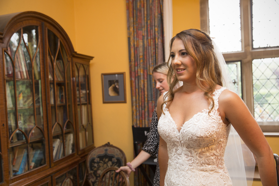 Bride ready to leave bridal suite and go to ceremony at Nettlestead Place wedding.