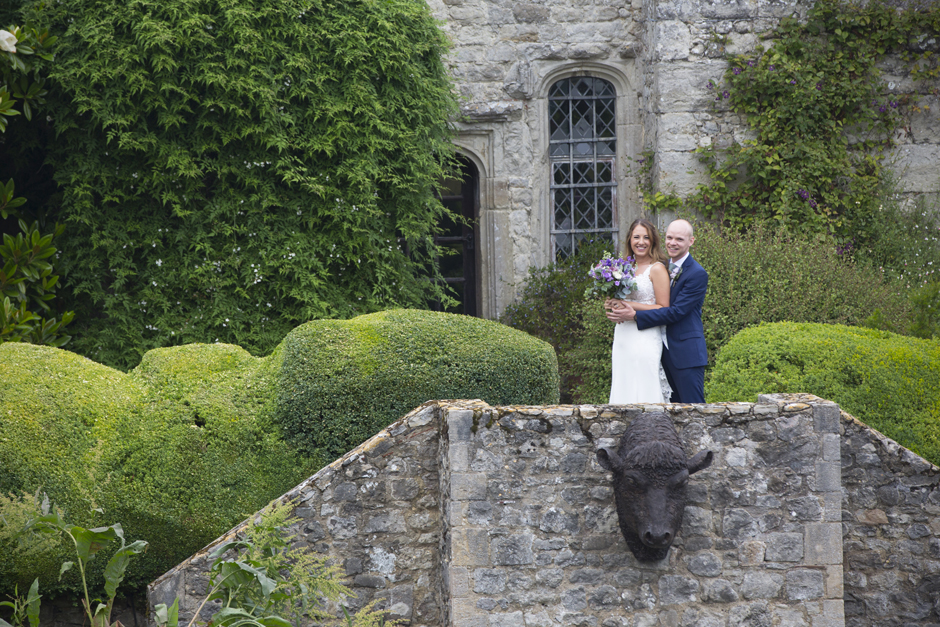 Bride and groom laughing at Nettlestead Place, Maidstone in Kent.