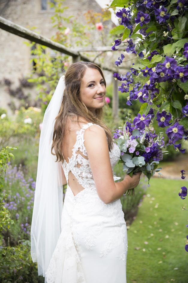 Bride portrait standing in the flower gardens at Nettlestead Place wedding in Maidstone, Kent.