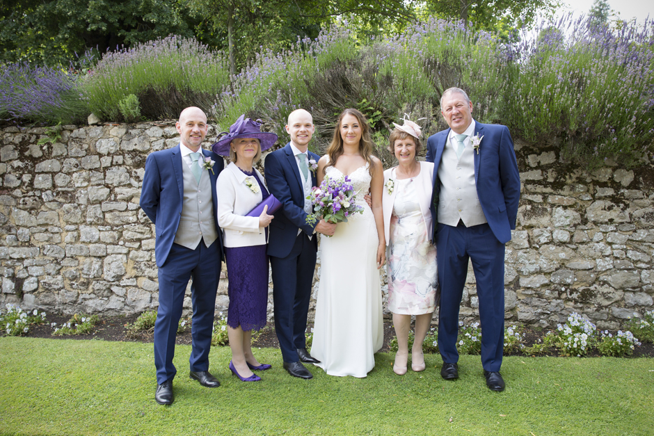 Bride and groom with their parents at Nettlestead Place wedding in Maidstone, Kent.