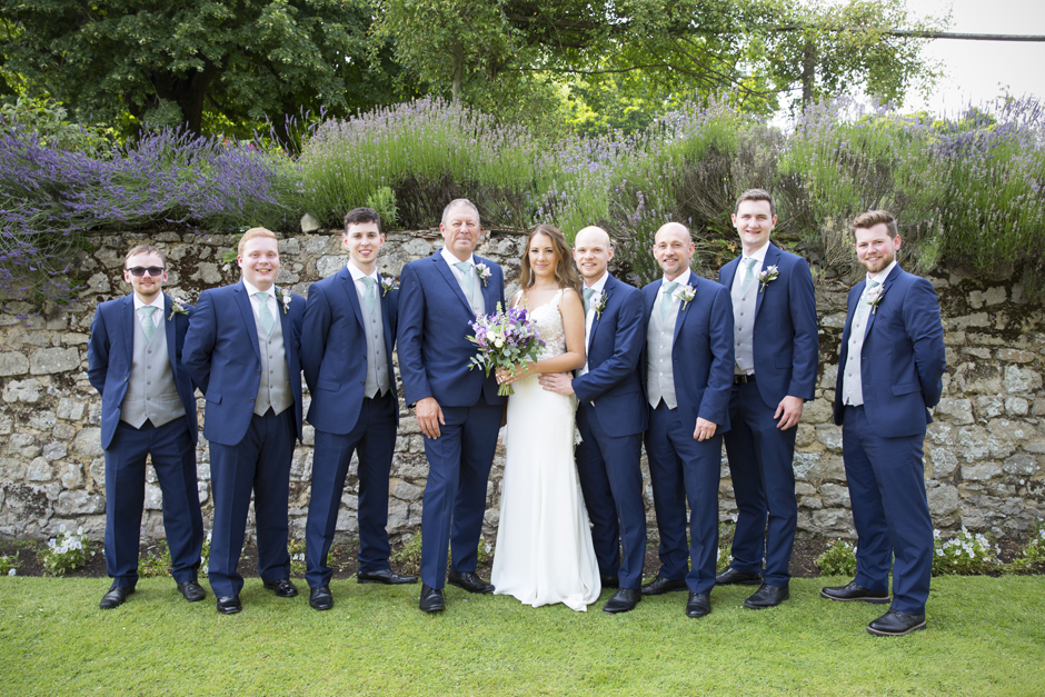 Bride and groom with groomsmen and fathers at Nettlestead Place wedding.