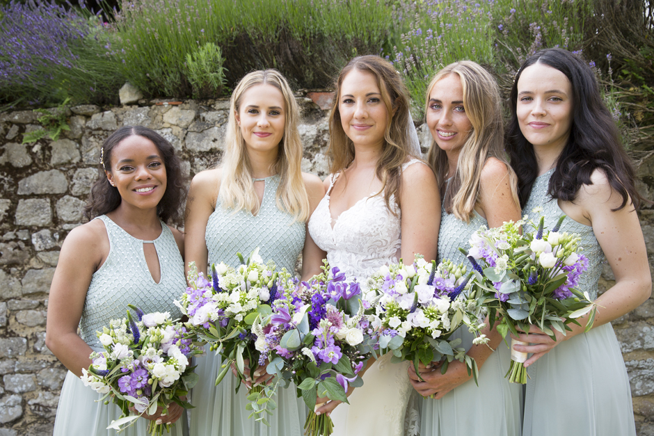 Close-up of bride and bridesmaids at Nettlestead Place wedding in Maidstone, Kent. Captured by Kent wedding photographer, Victoria Green.