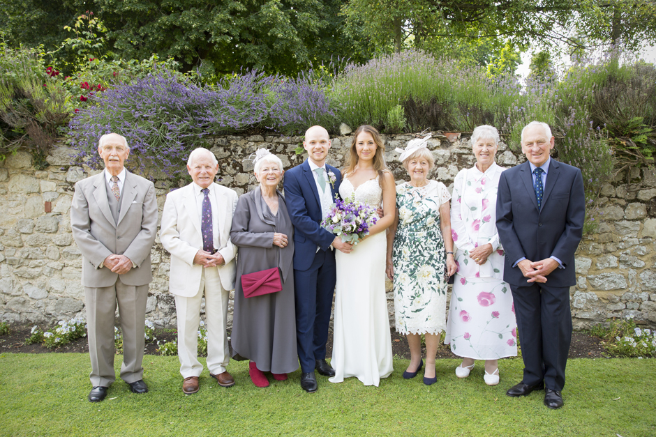 Bride and groom with wedding guests at Nettlestead Place, Maidstone in Kent.