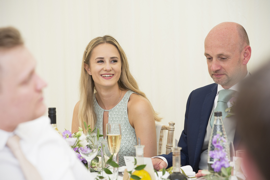 Bridesmaid laughing at speech at Nettlestead Place in Maidstone, Kent.