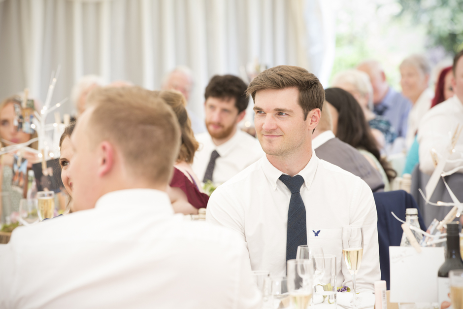 Wedding guest listening to speech at Nettlestead Place, Maidstone in Kent.