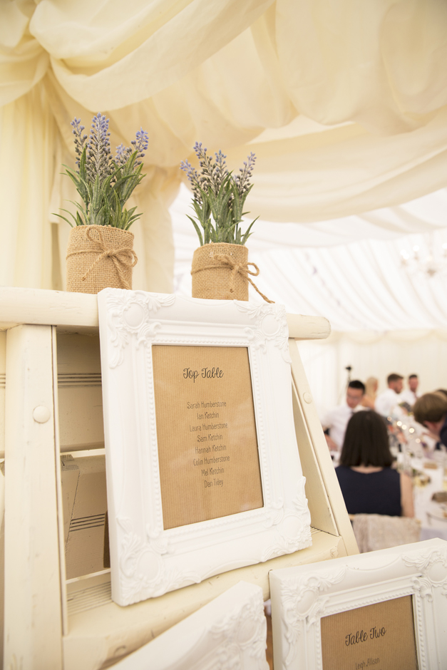 White vintage frames with top table details at Nettlestead Place in Maidstone, Kent.