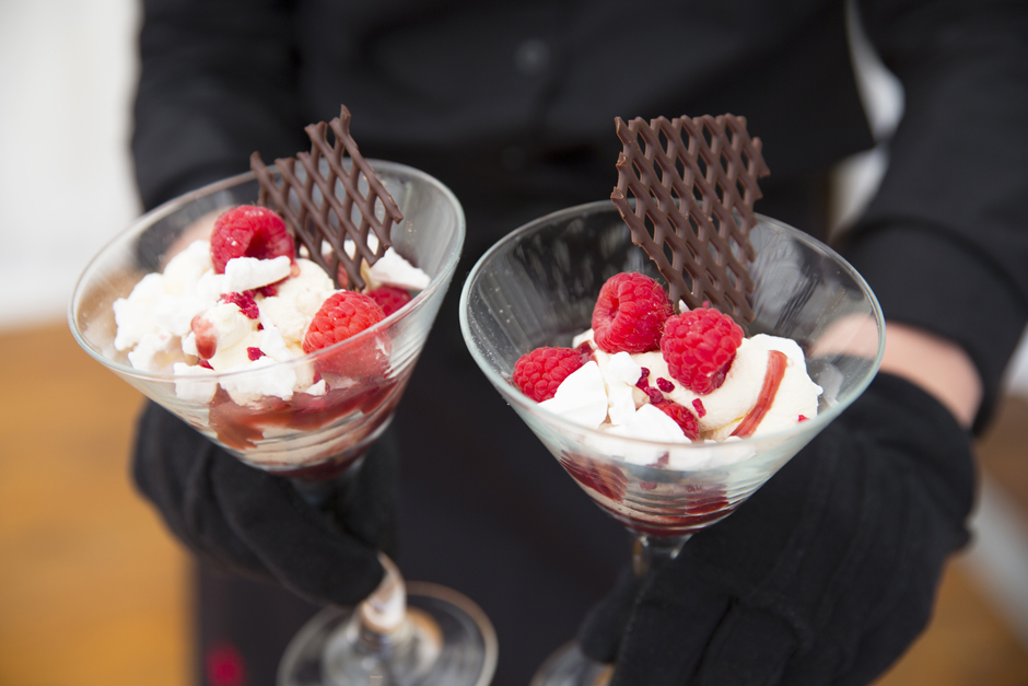 Wedding breakfast - two martini glasses holding eton mess with raspberries on top! Served at Nettlestead Place in Maidstone, Kent.