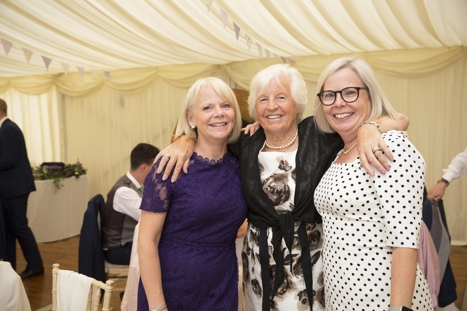 Three happy female wedding guests posing for a picture at Nettlestead Place wedding (Maidstone, Kent).