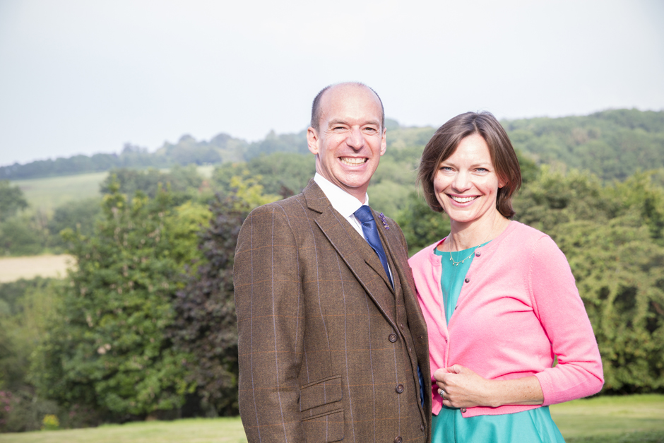 Couple smiling posing for a photograph at Nettlestead Place in Kent.