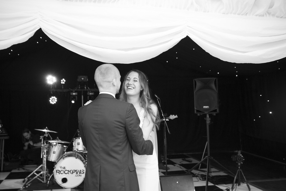 Bride and groom's first dance - bride laughing at groom, at Nettlestead Place in Kent. Captured by photographer Victoria Green.