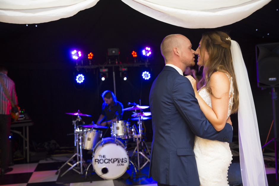 Bride and groom kissing on the dance floor at Nettlestead Place wedding in Maidstone, Kent.