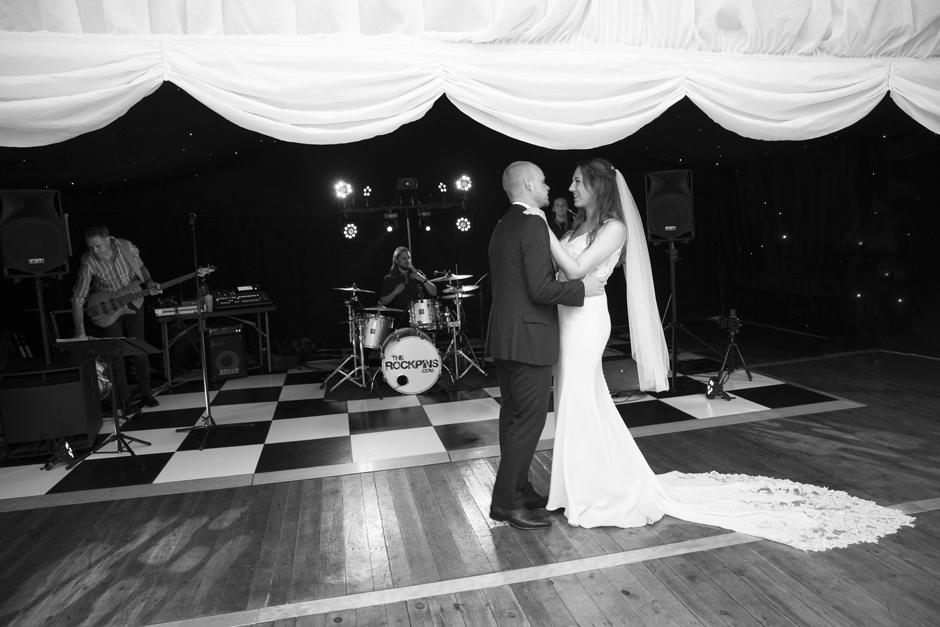 Bride and groom first dance with bride looking at groom. Captured at Nettlestead Place in Maidstone, Kent.